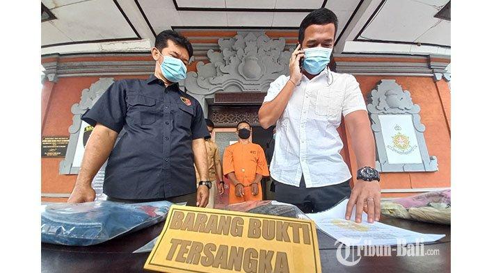 Sang Putu S (berpakaian oranye) saat dimintai keterangan di Sat Reskrim Polres Klungkung, Selasa (18/5/2021).