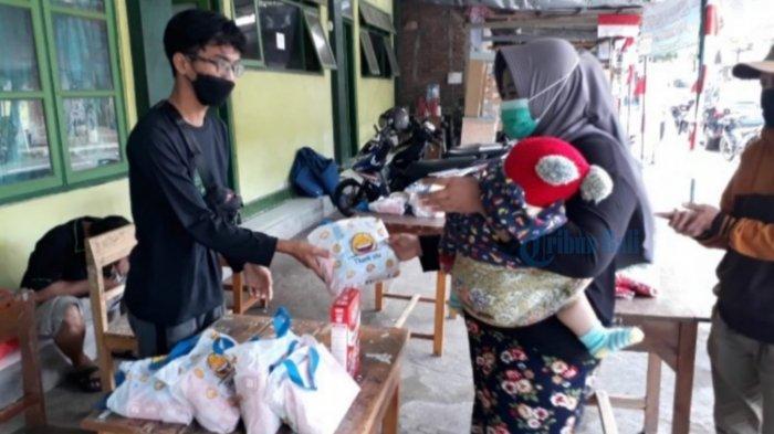 GPL Bagikan Susu Gratis Bagi Balita di Jembrana, Jamila: Sangat Terbantu