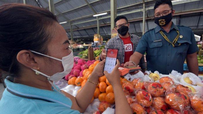 DOKU Sinergi Bank Mandiri dan MKP Mobile Semarang Dorong Digitalisasi Transaksi di Pasar Singaraja