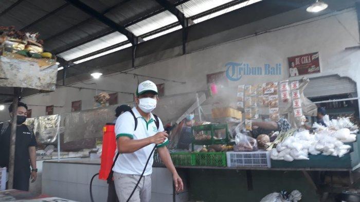 BREAKING NEWS: Hari Pertama PPKM Darurat, 3 Pasar di Denpasar Disemprot Cairan Eco Enzyme