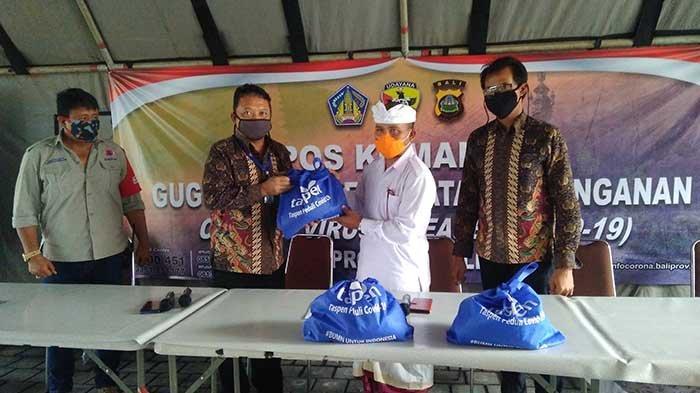 PT TASPEN (PERSERO) KC Denpasar Serahkan Puluhan Ribu Paket Bantuan Peduli Covid-19 di Bali