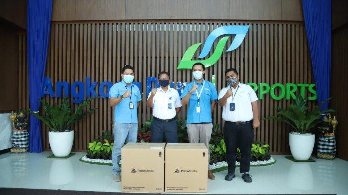 Antisipasi Penyebaran Covid-19, Manajemen Bandara Ngurah Rai Terima Bantuan 4 Ribu Masker