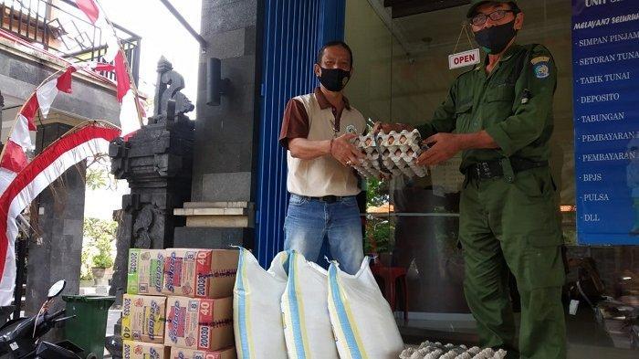 3 KK yang Menjalani Isolasi Mandiri di Desa Dangin Puri Klod Denpasar Diberikan Sembako