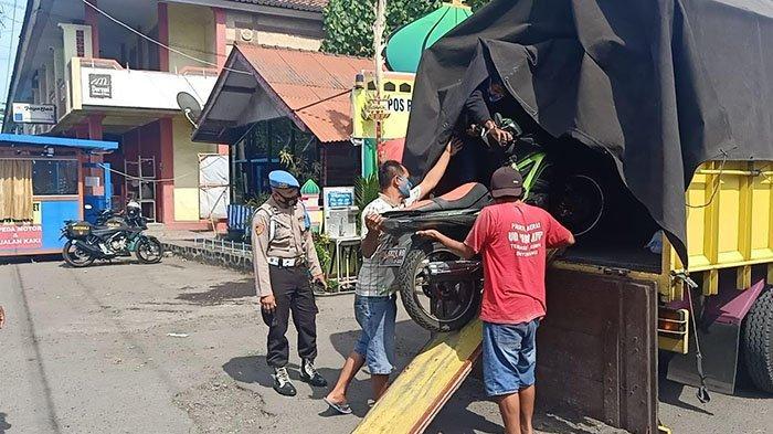 Bermaksud Kelabui Petugas, Truk Ketahuan Angkut Pemudik dan Sepeda Motor di Pelabuhan Gilimanuk