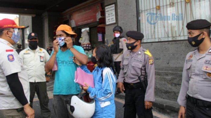 Tim Gabungan Polri dan Dinas Terkait di Badung Lakukan Pengawasan Prokes di Kantor Samsat Badung