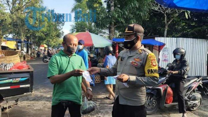 Dorong Warga Taat Prokes, Polsek Gianyar Bagikan Masker Gratis