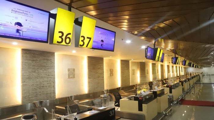 Suasana ruang Check in Bandara Internasional I Gusti Ngurah Rai Bali saat Nyepi, Minggu 14 Maret 2021.