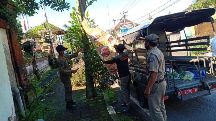 Sampai Saat Ini 27 Baliho Sudah Ditertibkan Satpol PP Badung,Termasuk Baliho Prokes Yang Robek