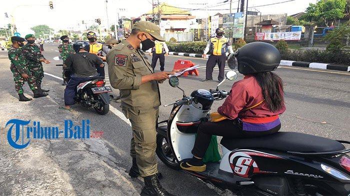 Sebanyak 31 Pengendara Diputar Balik di Perbatasan Denpasar, 2 Toko Dipasangi Stiker