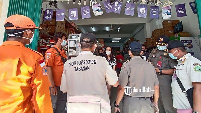 Pengawasan Terkait PPKM Darurat, Satu Per Satu Toko Non Esensial di Pasar Tabanan Diminta Tutup