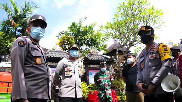 Sambil Cek Posko Covid-19 di Tabanan, Kabid Humas Polda Bali Beberkan Efektivitas PPKM Mikro
