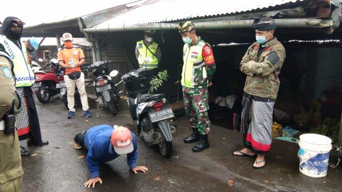 Tim Yustisi Tindak 8 Orang Pelanggar Prokes di Pasar Kintamani Bali
