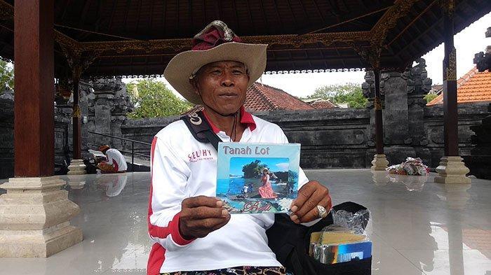 Kisah Nyoman Murdi, Tukang Foto Keliling di Tanah Lot yang Kian Tak Dilirik Wisatawan