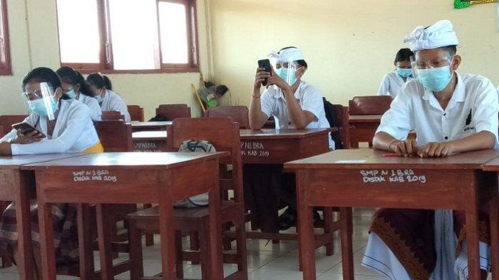 Persiapan Jelang Pembelajaran Tatap Muka,SMPN 1 Banjarangkan Gelar Ujian Daring di Sekolah
