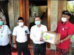 anggota-komisi-ix-dpr-ri-ketut-kariyasa-adnyana-menyerahkan-bantuan-hibah-dari-kementerian.jpg