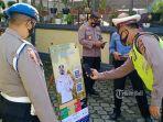 anggota-polisi-diwajibkan-scan-aplikasi-pedulilindungi-sebelum-masuk-mapolsek-kota-negara.jpg