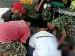 anggota-prajurit-yonif-r-900sbw-dan-warga-saat-membantu-korban-laka-lantas.jpg