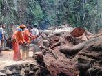 bpbd-bangli-bersama-masyarakat-dusun-bunut-madya-melakukan-evakuasi-material-pohon-tumbang.jpg