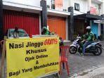 driver-ojek-online-di-kawasan-denpasar-bali-mengantre-untuk-mendapatkan-nasi-bungkus-gratis.jpg