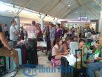 efek-gempa-bumi-ribuan-turis-menumpuk-di-bandara-lombok-praya_20180806_183357.jpg