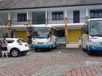 ilustrasi-bus-damri-di-tempat-parkir-pasar-terminal-loka-crana-bangli-bali-rabu-1062020.jpg