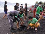 kegiatan-bakti-sosial-yang-dilakukan-lanal-denpasar-kepada-masyarakat-di-pantai-monggalan.jpg