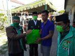 ketua-pkb-bali-bambang-sutiyono-tengah-saat-menyalurkan-bantuan-paket-sembako.jpg