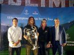 legenda-fc-barcelona-carles-puyol-mengangkat-trofi-liga-champion.jpg