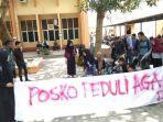 mahasiswa-fisip-unila-mendirikan-posko-peduli-aga.jpg