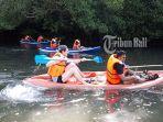 naik-kano-menyusuri-mangrove-di-kawasan-dam-estuari-pemogan-denpasar.jpg