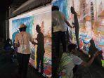 para-mahasiswa-ikip-pgri-bali-membantu-program-seni-mural-di-sesetan.jpg