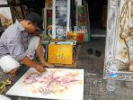 pedagang-lukisan-di-pasar-seni-sukawati_20170116_232050.jpg
