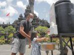 pengunjung-mencuci-tangan-di-monumen-bajra-sandhi-di-renon.jpg