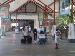 penumpang-di-bandara-i-gusti-ngurah-rai-bali-12.jpg