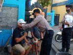 personel-polsek-nusa-penida-bagi-bagi-masker-di-pelabuhan-banjar-nyuh.jpg