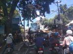pohon-rimbun-tutupi-rambu-lalu-lintas-di-sanglah-denpasar_20180315_190702.jpg