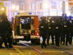 polisi-menyisir-di-tempat-kejadian-setelah-terdengar-suara-tembakan-di-vienna-austria.jpg