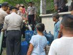 polres-klungkung-mendistribusikan-air-bersih-ke-warga-di-desa-besan.jpg