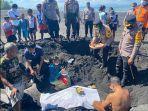 proses-penguburan-ikan-hiu-tutul-yang-ditemukan-terdampar-di-pesisir-pantai-tegal.jpg
