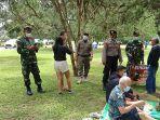 satgas-enforce-kerumunan-tabanan-saat-melakukan-patroli-di-areal-kebun-raya-eka-karya.jpg