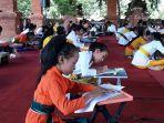 siswa-mengikuti-lomba-nyurat-aksara-bali-dalam-bulan-bahasa-bali-kota-denpasar.jpg