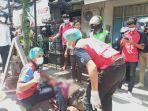 terlihat-petugas-pmi-kota-denpasar-saat-melakukan-evakuasi-korban-tabrak-lari.jpg
