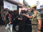 tim-yustisi-denpasar-menjaring-32-orang-pelanggar-prokes-di-tl-jalan-gelogor-carik-denpasar-selatan.jpg