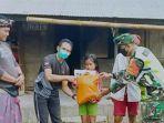 tni-ad-bersama-komunitas-trail-di-bali-bantu-kelompok-anak-yatim.jpg