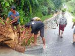 warga-bersama-aparat-saat-melakukan-bersih-bersih-di-lokasi-sebuah-pohon.jpg