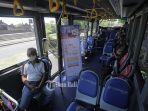 warga-mencoba-fasilitas-bus-listrik-dalam-ujicoba-bus-listrik-di-denpasar.jpg