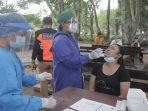 warga-mengikuti-rapid-tes-antigen-gratis-di-lapangan-puputan-badung-denpasar-sabtu.jpg