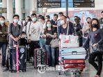 wisatawan-menggunakan-masker-antisipasi-virus-corona.jpg