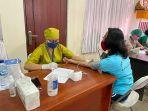 wpb-lapas-perempuan-kelas-ii-a-kerobokan-memperoleh-vaksinasi-dosis-pertama.jpg