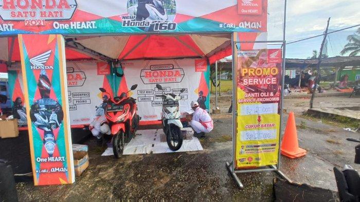 Service Pkonomis dengan Hanya Membayar Rp 25.000,. pada Roadshow Satu Hati Honda TDM Payung